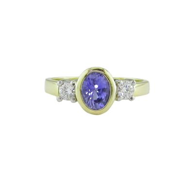 Diamond Rings 18ct. Yellow Ring set with Burma Sapphire and 2 Diamonds