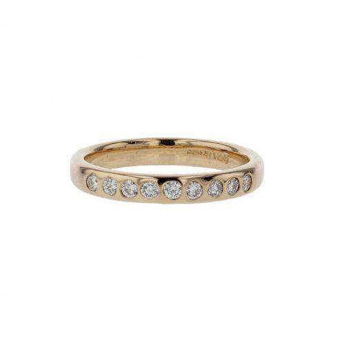 Rings 18ct. Rose Gold Ring, 9 Gypsy set Diamonds
