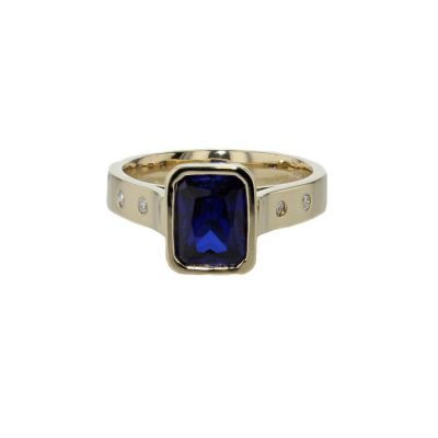 Dress Rings Emerald Cut Sapphire and Diamond Ring